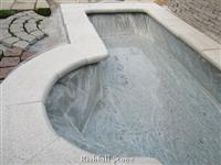 white quartz pool surrounds tile
