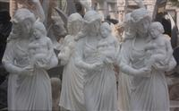 mother and children carving sculpture