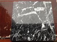 black margiua marble slab and tile