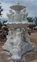 Sculptured white marble fountain