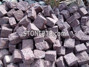 Red hand-made cubic stone